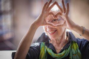 Senior holding love heart