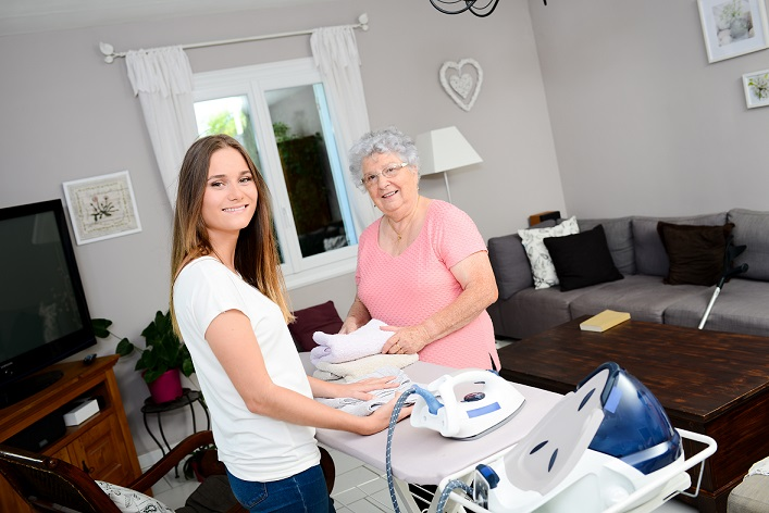 picture of a carer doing ironing